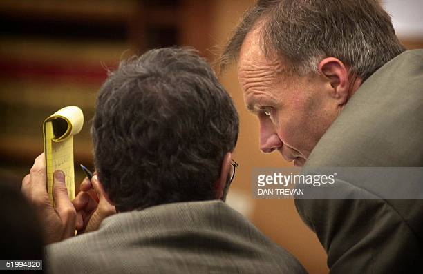 Defense attorneys Robert Boyce and Steven Feldman confer during questioning of witnesses during the trial of David Westerfield, 10 June 2002, at the...