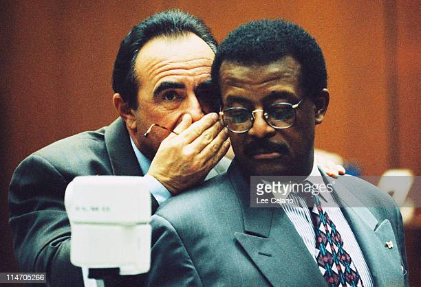 Defense attorneys Robert Shapiro and Johnnie Cochran confer during testimony in the OJ Simpson Criminal Trial February 9 1995