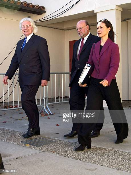 Defense attorneys Thomas A. Mesereau Jr., Robert Sanger and Susan C. Yu exit the Santa Barbara County Superior Courthouse for a lunch break during a...