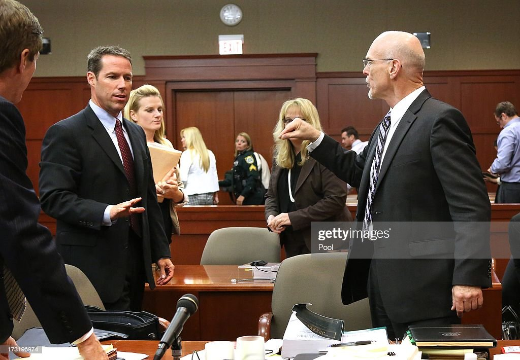 Defense counsel Don West angrily talks to assistant state attorney John Guy after court recesses in the George Zimmerman trial in Seminole circuit court, July 9, 2013 in Sanford, Florida. Zimmerman has been charged with second-degree murder for the 2012 shooting death of Trayvon Martin.