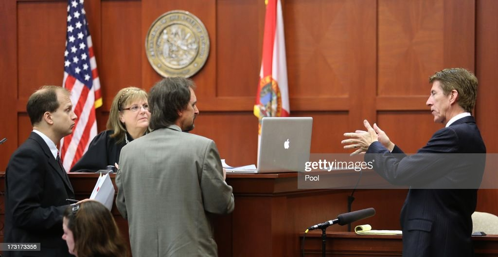 Defense counsel Mark O'Mara (far right) addresses forensics animation expert Daniel Shumaker as he testifies, with Assistant State Attorney Richard Mantei (far left) and Judge Debra Nelson looking on in the George Zimmerman trial in Seminole circuit court, July 9, 2013 in Sanford, Florida. Zimmerman has been charged with second-degree murder for the 2012 shooting death of Trayvon Martin.