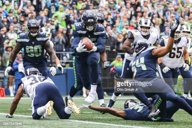 Defense End Frank Clark of the Seattle Seahawks intercepts the ball in the first half agains the Los Angeles Rams at CenturyLink Field on October 7...