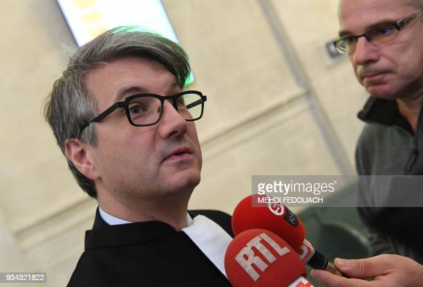 Defense lawyer Arnaud Dupin answers journalists' questions on March 19 2018 at Bordeaux's courthouse prior to the opening hearing of the trial of his...