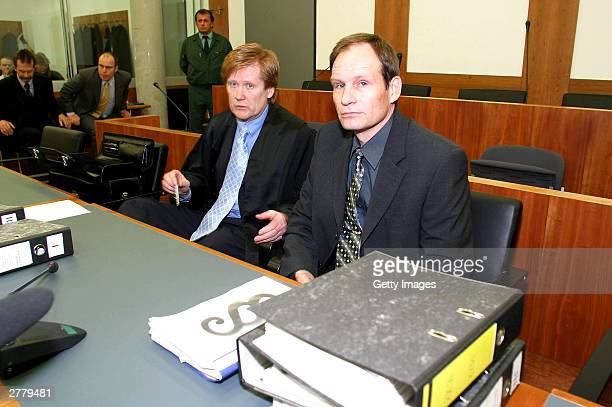Defense Lawyer Harald Ermel is seen with Computer technician Armin Meiwes aged 42 at the prelude to Germany's first cannabalism trial held before the...