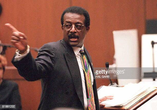 Defense lawyer Johnnie Cochran Jr points to the door OJ Simpson will walk out if the jury found Simpson not guilty 27 September while he addresses...