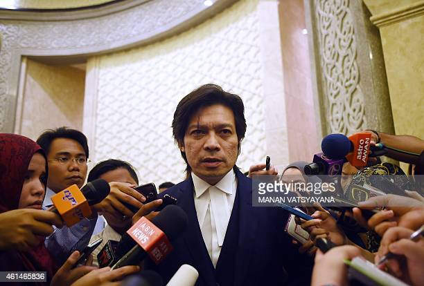 Defense lawyer Kamarul Hisham Kamaruddin addresses mediapersons after the verdict to restore the death sentence against Azilah Hadri and Sirul Azhar...