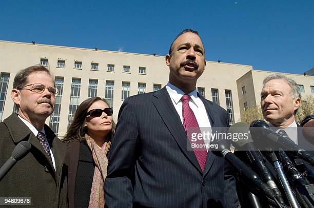 Defense lawyer Ted Wells center front delivers a statement to the media outside the the US Federal Courthouse in Washington DC as defense lawyer...