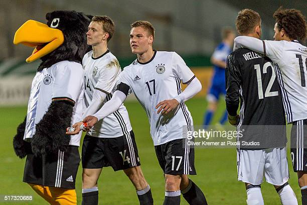 Defense Lukas Klostermann of Germany and Midfielder Max Christiansen of Germany throw chocolate eggs into the audience at Frankfurter...