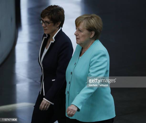 Defense Minister Annegret KrampKarrenbauer and German Chancellor Angela Merkel arrive for the SwornIn ceremony in the PaulLoebe Haus at the German...
