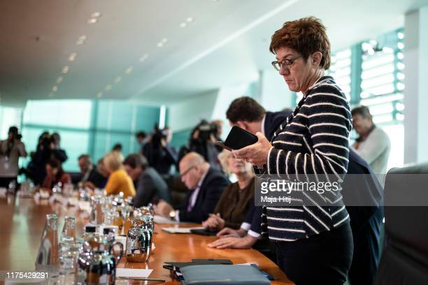 Defense Minister Annegret KrampKarrenbauer looks at her phone prior to the Weekly Government Cabinet Meeting at the Chancellery on September 18 2019...