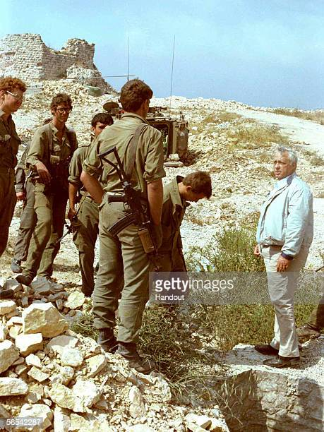 Defense Minister Ariel Sharon meets with Israeli army troops after the army's battle with Palestinian gunmen June 7 1982 at Beaufort Castle in...