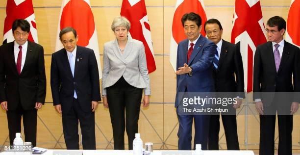 Defense Minister Itsunori Onodera Chief Cabinet Secretary Yoshihide Suga British Prime Minister Theresa May Japanese Prime Minister Shinzo Abe Deputy...