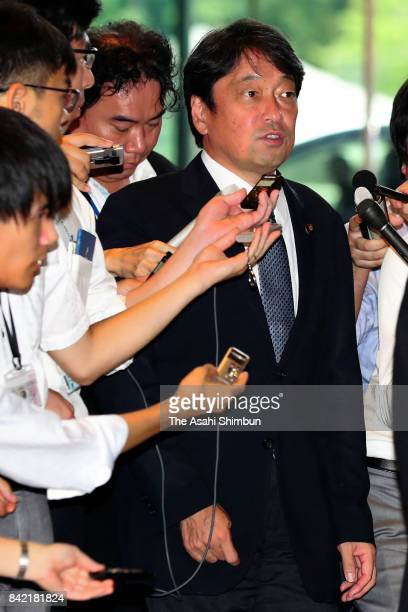 Defense Minister Itsunori Onodera is surrounded by media reporters on arrival at the prime minister's official residence after North Korea's nuclear...