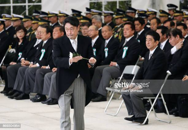 Defense Minister Itsunori Onodera offers a flower during the ceremony commemorating SelfDefense Force members who lost their lives on duty at the...