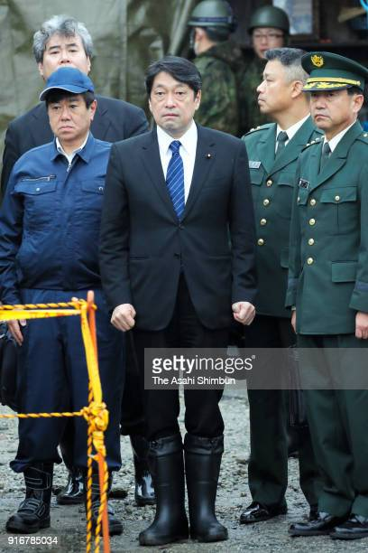Defense Minister Itsunori Onodera receives an explanation from Ground SelfDefense Force officials about damage to the private residence from the...