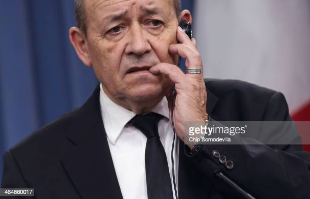 Defense Minister JeanYves Le Drian listens to reporters' questions during a news conference with US Defense Secretary Chuck Hagel at the Pentagon...