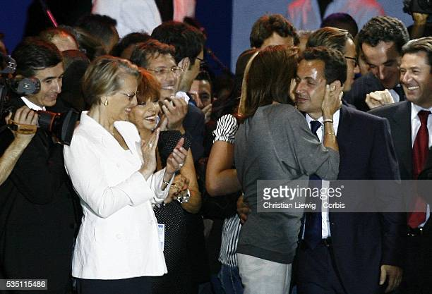 Defense Minister Michelle AlliotMarie watches as Cecilia Sarkozy kisses her husband Nicolas Sarkozy at the concert celebrating his victory in the...
