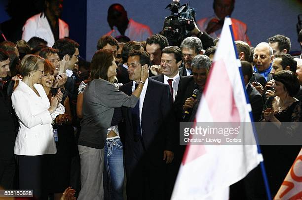 Defense Minister Michelle AlliotMarie watches as Cecilia Sarkozy kisses her husband Nicolas Sarkozy at the concert celebrating the victory of Sarkozy...