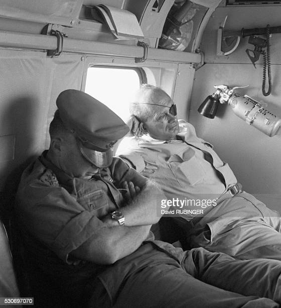 Defense Minister Moshe Dayan and Chief of Staff Yitzhak Rabin fly back from the battlefield on the day after the SixDay War