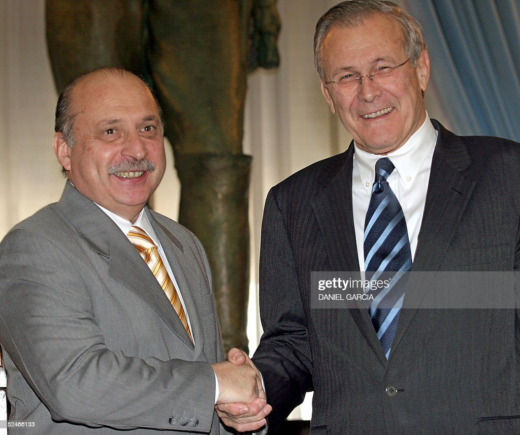 defense-minister-of-argentina-jose-pampuro-shakes-hands-with-us-picture-id52466133