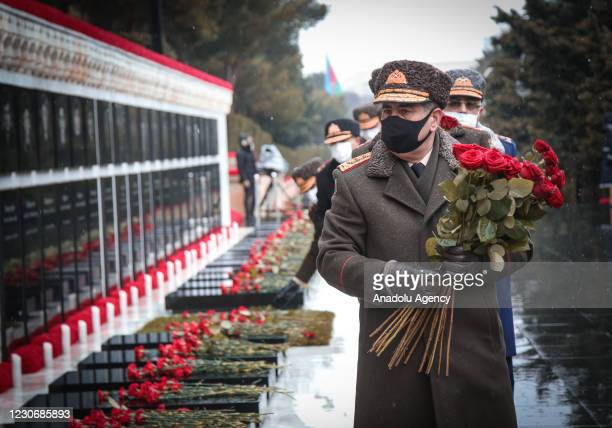 Defense Minister of Azerbaijan Zakir Hasanov and other officials attend a commemoration ceremony within Azerbaijans 31st year of Black January, a...