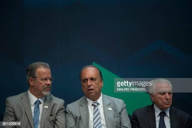 Defense Minister Raul Jungmann Rio de Janeiro's Governor Luiz Fernando Pezao and the Brazilian President Michel Temer take part in an event...