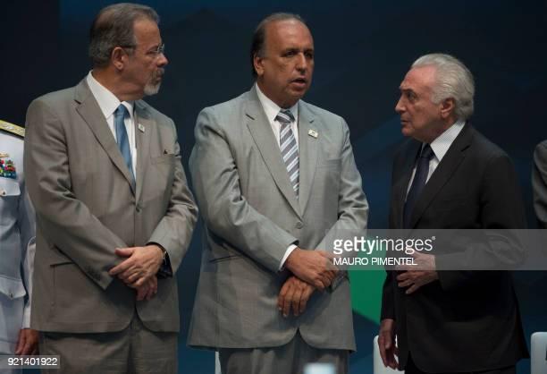 Defense Minister Raul Jungmann Rio de Janeiro's Governor Luiz Fernando Pezao and Brazilian President Michel Temer take part in an event announcing...