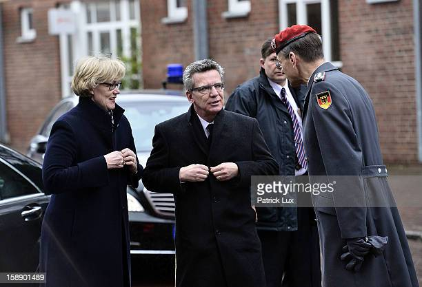 Defense Minister Thomas de Maiziere and his wife Martina are greeted by Colonel Hubertus von Rohr head of the protocol at the Defense ministy as they...