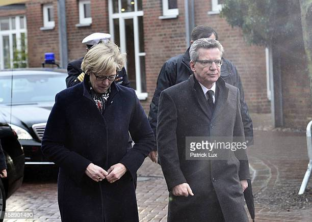 Defense Minister Thomas de Maiziere and his wife Martina arrive at a memorial service for former German Defence Minister Peter Struck on January 3,...