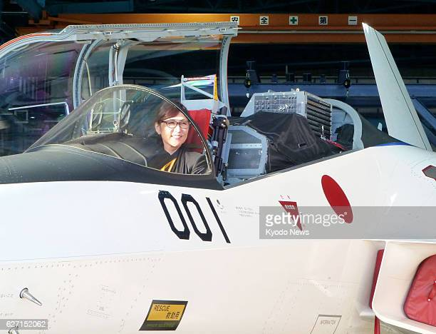 Defense Minister Tomomi Inada sits in the cockpit of a prototype of Japan's first domestically developed stealth fighter at an Air SelfDefense Force...