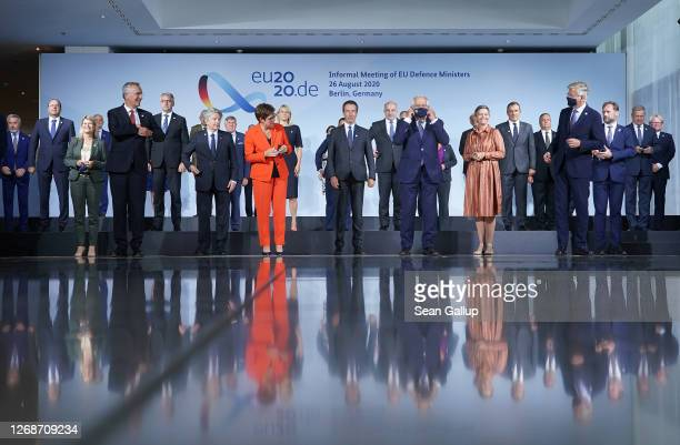 Defense ministers of European Union member states and other participants arrange themselves for a group photo during a meeting on August 26 2020 in...