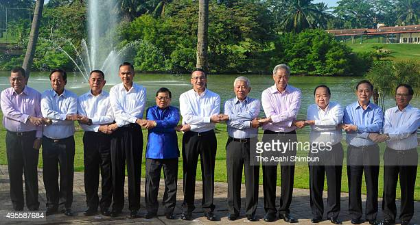 Defense ministers of the ASEAN pose for photographs during their meeting on November 3 2015 in Kuala Lumpur Malaysia