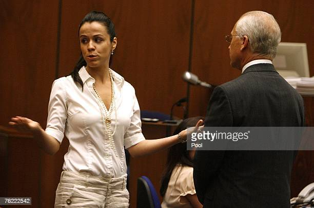 Defense rebuttal witness Tanara Henson acts out an encounter she had with Lana Clakrson at a party with defense attorney Roger Rosen during Phil...