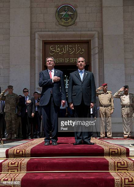 S Defense Secretary Ash Carter and Iraqi Defense Minister Khalid alObeidi stand for their country's national anthems as Carter arrives at the...