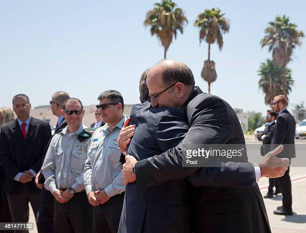 S Defense Secretary Ash Carter embraces Israeli Defense Minister Moshe Ya'alon on the tarmac before he boards a C17 military aircraft at Ben Gurion...
