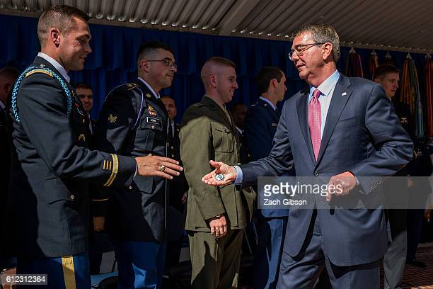 S Defense Secretary Ash Carter hands out challenge coins during a ceremony honoring 2016 active duty military Olympians and Paralympians at The...