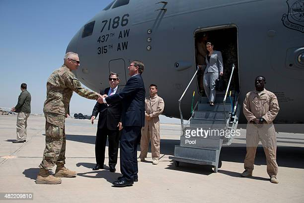 S Defense Secretary Ash Carter is greeted by US Ambassador to Iraq Stu Jones center and Army Lt Gen James Terry left as he arrives at the Baghdad...
