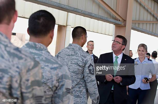 S Defense Secretary Ash Carter joined by Col Jeannie Leavitt right hands out challenge coins as he meets with US troops July 21 2015 at a Jordanian...