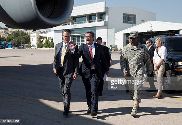 S Defense Secretary Ash Carter joined by US Army Lt Gen Ron Lewis right and Chief of Staff Eric Rosenbach left boards his plane at Queen Alia Airport...
