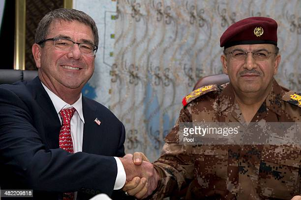 S Defense Secretary Ash Carter left and Gen Taleb Shegati AlKenani commander of the Counter Terrorism forces shake hands as they meet at the Combined...