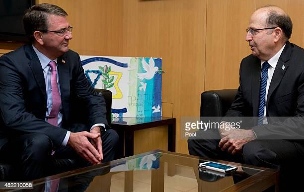 S Defense Secretary Ash Carter left and Israeli Defense Minister Moshe Ya'alon meet at Israel's Defense Force headquarters in Tel Aviv Israel Monday...