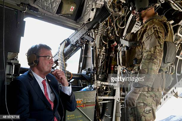 S Defense Secretary Ash Carter rides on a Chinook helicopter July 23 2015 in Baghdad Iraq Carter is on a week long tour of the Middle East focused on...