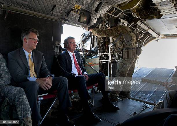 S Defense Secretary Ash Carter rides on a Chinook helicopter with his Chief of Staff Eric Rosenbach July 23 2015 in Baghdad Iraq Carter is on a week...