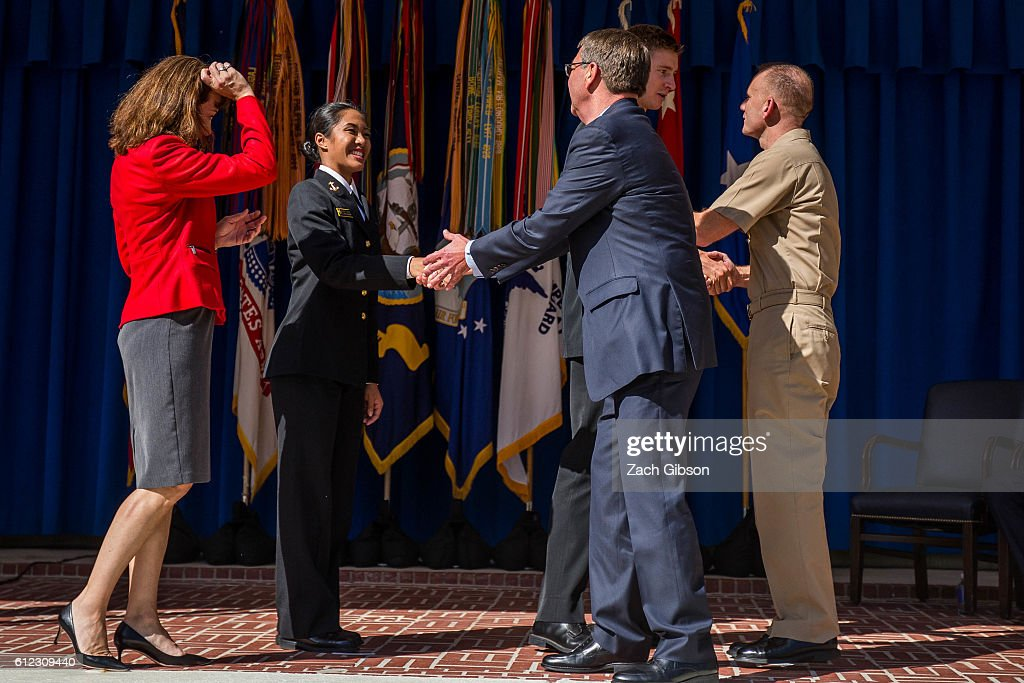U.S. Defense Secretary Ash Carter shakes hands with 100-meter dash sprinter U.S. Naval Academy Midshipman Regine Tugade during a ceremony honoring 2016 active duty military Olympians and Paralympians at The Pentagon on October 3, 2016 in Arlington, Virginia. The ceremony hosted 20 members of the U.S. military who competed in the 2016 games.