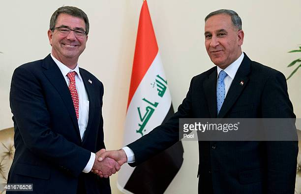 S Defense Secretary Ash Carter shakes hands with Iraqi Defense Minister Khalid alObeidi July 23 2015 at the Ministry of Defense in Baghdad Iraq...