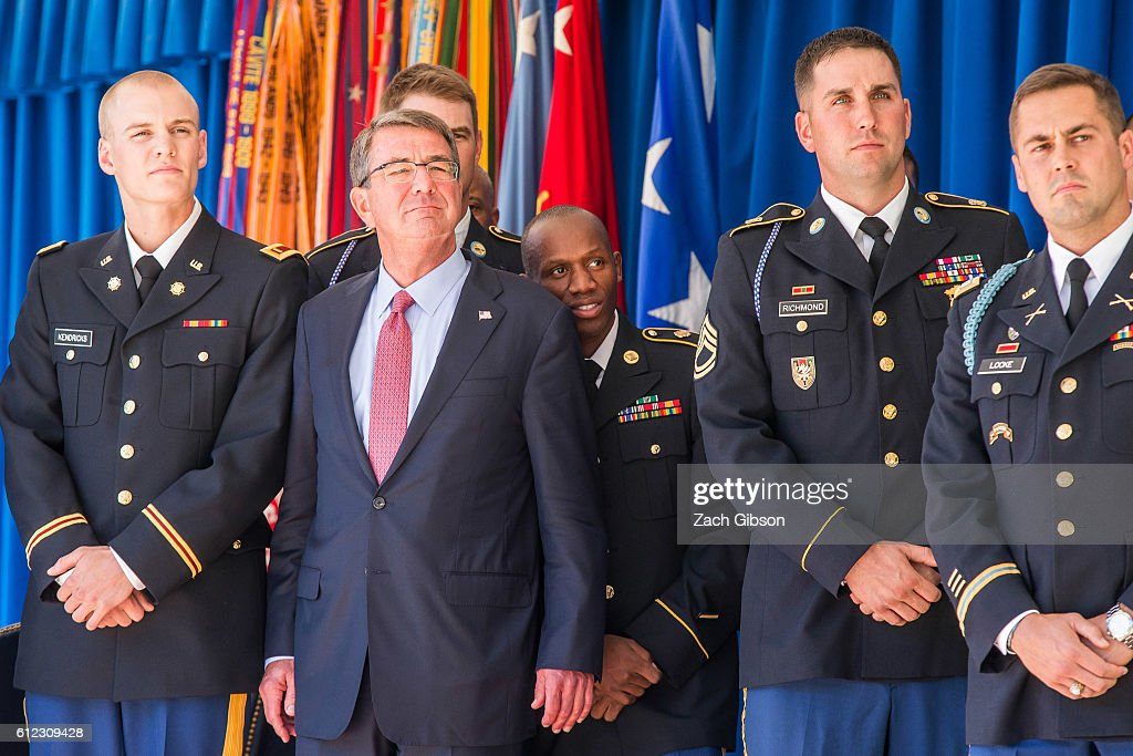U.S. Defense Secretary Ash Carter stands between pole vaulter Army 2nd Lt. Sam Kendricks, left, and 3000-meter steeplechaser Army Spc. Hillary Bor during a ceremony honoring their performance during the 2016 Rio Olympics at The Pentagon on October 3, 2016 in Arlington, Virginia. The ceremony hosted 20 members of the U.S. military who competed in the 2016 games. Also pictured at right are Army Sgt. 1st Class Josh Richmond, and Army Capt. Andrew Locke.