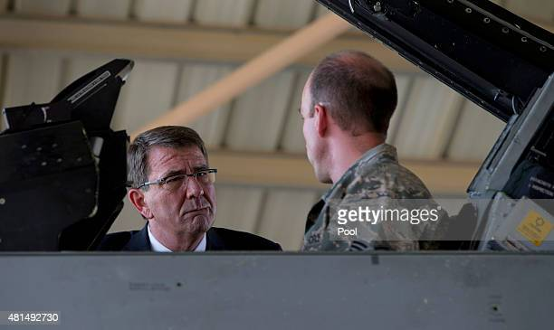 S Defense Secretary Ash Carter talks with Staff Sgt Jesse Simmons as he sits in the cockpit of an F16 Air Force fighter July 21 2015 at a Jordanian...