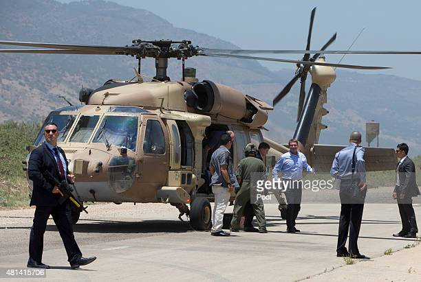S Defense Secretary Ash Carter third from right and Israeli Defense Minister Moshe Ya'alon arrive on a UH60 Blackhawk helicopter at a Hula Valley...