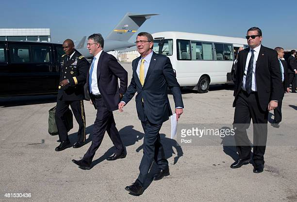 S Defense Secretary Ash Carter walks along the tarmac with US Army Lt Gen Ron Lewis and Chief of Staff Eric Rosenbach and members of his security...