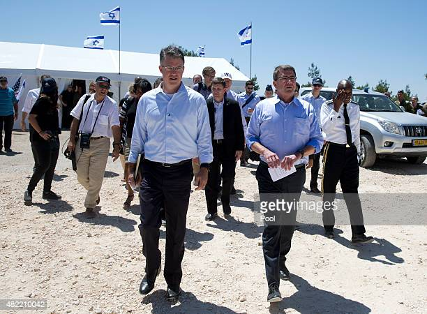 S Defense Secretary Ash Carter walks with his Chief of Staff Eric Rosenbach left and US Army Lt Gen Ron Lewis right to talk to the media after...